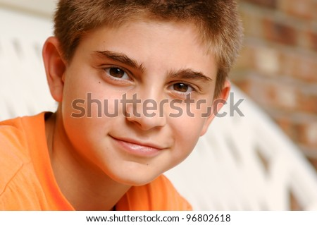 Head and shoulders portrait of a smart 10 year old boy