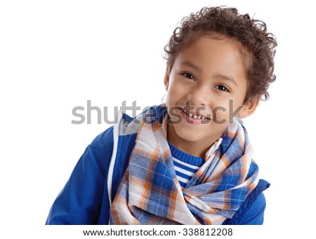 Head and shoulders portrait of a young boy wearing a jacket, scarf and knit hat.  Isolated on white with room for your text.