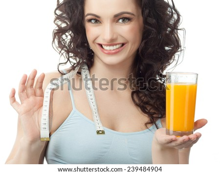 head and shoulders portrait of attractive  caucasian smiling woman isolated on white studio shot drinking orange juice face skin  - stock photo