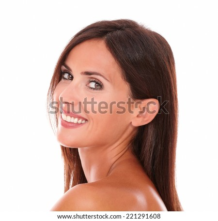 Head and shoulders portrait of beautiful latin woman showing her facial care while looking and smiling at camera on isolated studio - stock photo