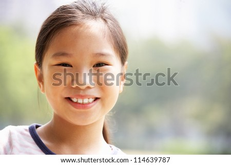 Head And Shoulders Portrait Of Chinese Girl