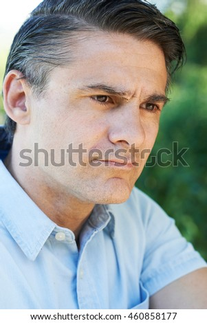Head And Shoulders Portrait Of Concerned Mature Man