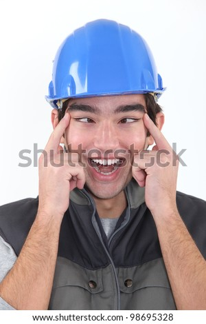 head and shoulders portrait of European craftsman passing for Chinese - stock photo