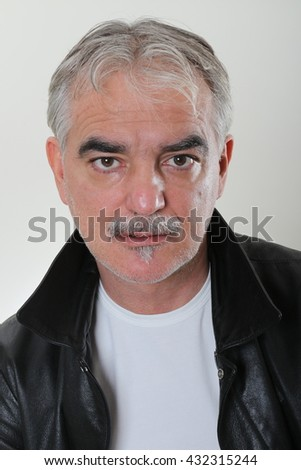 Head and shoulders portrait of mature handsome man