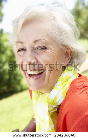 Head And Shoulders Portrait Of Smiling Senior Woman - stock photo