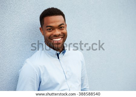 Head and shoulders portrait of young African American man - stock photo