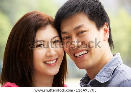 Head And Shoulders Portrait Of Young Chinese Couple