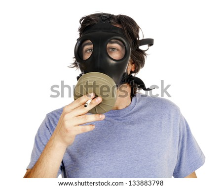 Head and shoulders view of an adult (early 30's) Caucasian man wearing a gas mask and smoking a cigarette through the filter. Isolated on white background.