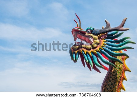 Head Dragon statue in Public Chinese shrine on sky background