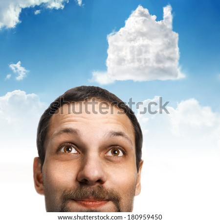Head in the clouds. Visualization / head of a happy man with a mustache who dream of a house  - stock photo