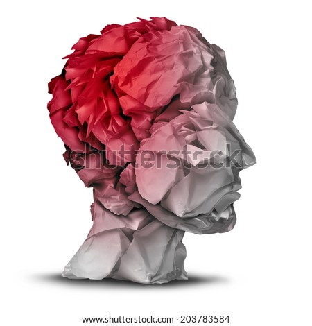 Head injury and traumatic brain accident medical  and mental health care concept with a group of crumpled office paper shaped as a human mind with red highlighted area as a symbol of trauma problem. - stock photo