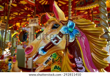 Head of a vintage horse  of amusement ride on merry-go-round carousel.  Amusement concept - stock photo