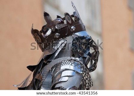 Head of an iron statue  of a horse-rider in the historic city of Briancon, France - stock photo