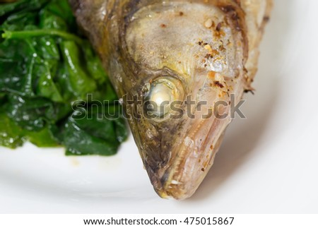 Head of baked dorado fish. Macro. Photo can be used as a whole background.