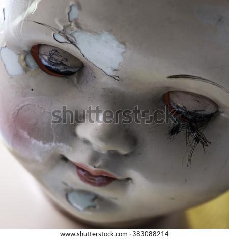 head of beatiful scary doll like from horror movie - evil face, grunge, macro - stock photo