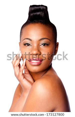 Head of Beautiful young African woman with Mohawk hand on face and bare shoulder, skincare concept, on white. - stock photo