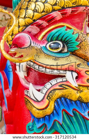 head of dragon statue decorate on pole - stock photo