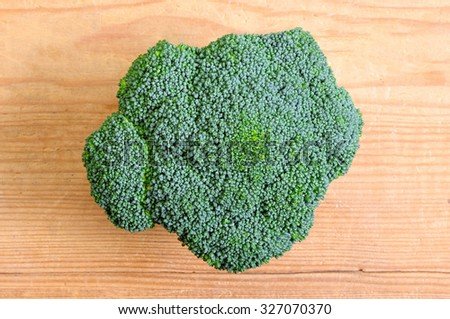 Head of Green Broccoli on Table  Ready to Cut - stock photo