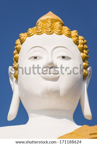 Head of  large Buddha statue at Wat Prathat Doi Kam in Chiang ma