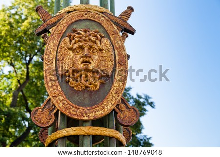 Head of Medusa Gorgon on the shield. Decorative lantern of the Panteleymonovsky Bridge, St.Petersburg, Russia - stock photo