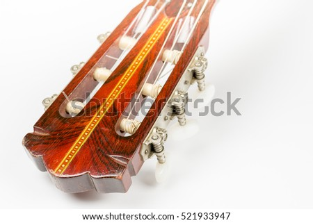 Head of the acoustic guitar over white background with copy space