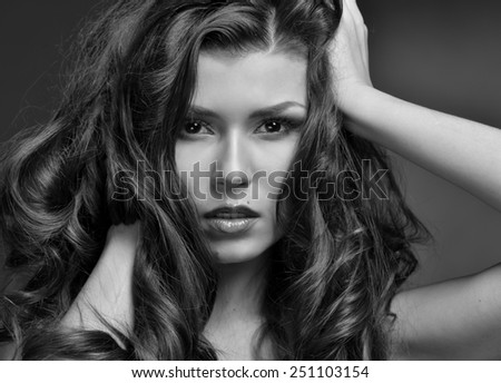 Head of the beautiful woman with long hair. Monochrome image.