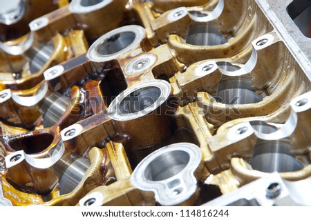 Head of the cylinders  block on a workshop table - stock photo
