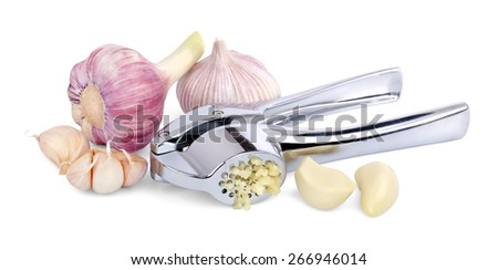 Head of young and mature garlic, unpeeled and shelled garlic cloves, crushed in a special masher, isolated on white background.