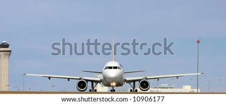 head on commercial jet on runway - stock photo