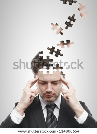 head puzzles businessman  on a white background - stock photo