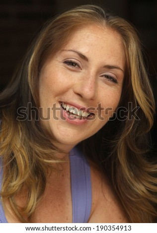 Head shot of a Blond Woman, indoors
