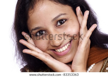 Head shot of cheerful young woman against white