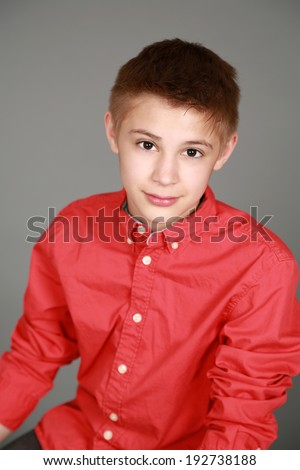 head shot of handsome preteen boy looking at camera  - stock photo