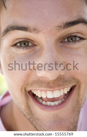 Head shot of man smiling - stock photo