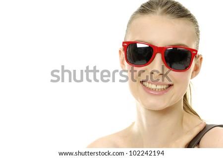 Head shot of smile oman wearing sunglasses - stock photo