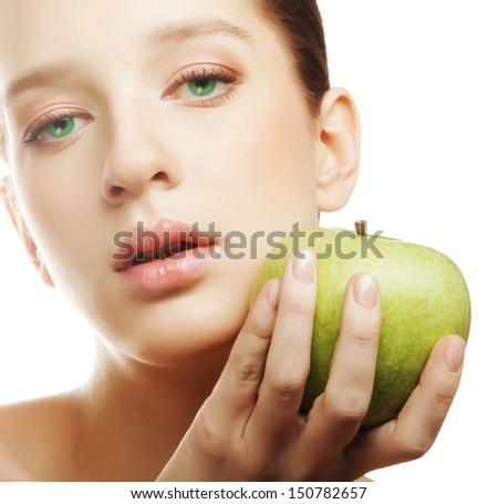Head shot of woman holding apple