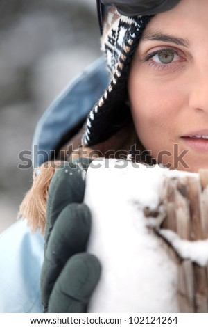 Head-shot of woman in the snow - stock photo