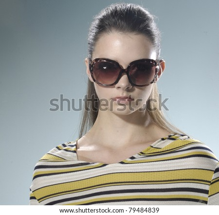 Head shot of woman wearing sunglasses - stock photo