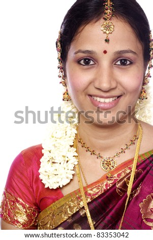 Head shot of young traditional woman against white