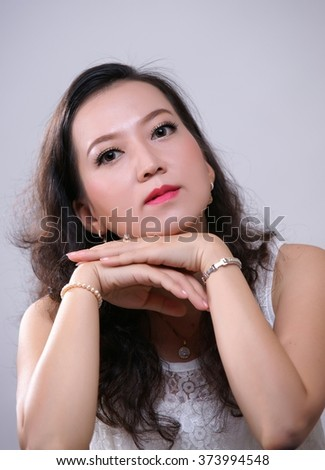 Head Shot Portrait of Attractive Smiling Elegant Woman - stock photo