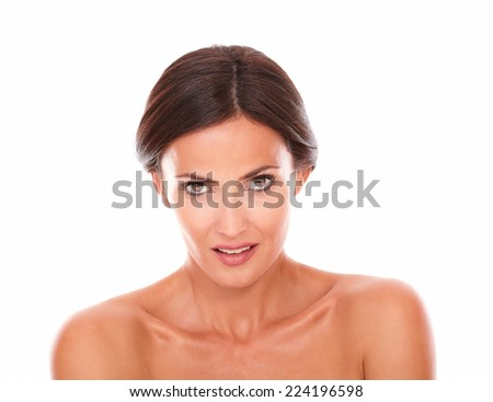 Head shot portrait of stylized surprised woman for natural beauty product looking to her right with nude shoulders on isolated white background - copyspace