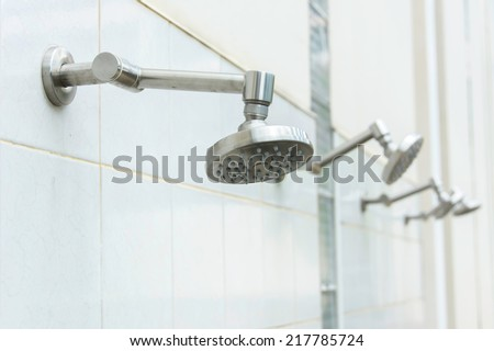 head shower at swimming pool - stock photo
