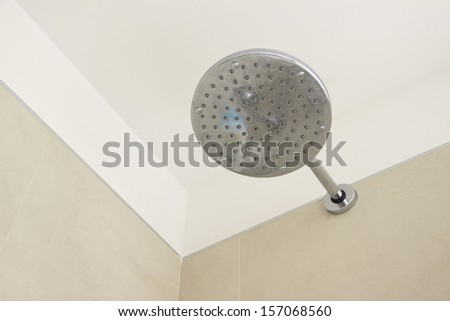 Head shower on the ceramic bathroom wall - stock photo