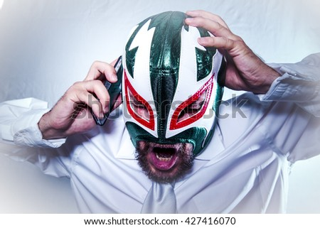 Headache, angry businessman with Mexican wrestler mask, expressions of anger and rage - stock photo