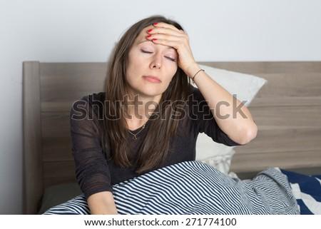 headache in bed - stock photo