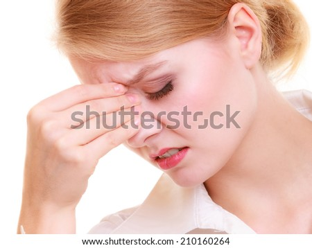 Headache, migraine and sinus ache. Stressed businesswoman worried young woman suffering from head or nose pain isolated on white.