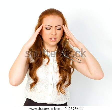 Headache, migraine and stress. Worried businesswoman upset woman suffering from head pain - stock photo