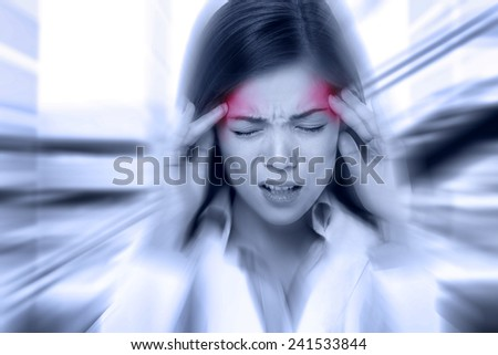 Headache migraine people - Doctor woman stressed. Woman Nurse / doctor with migraine headache overworked and stressed. Health care professional in lab coat wearing stethoscope at hospital. - stock photo