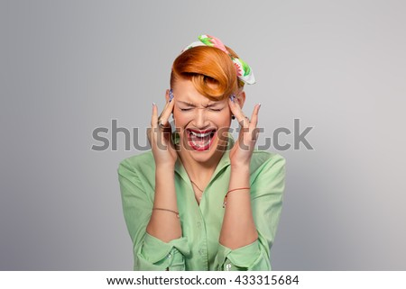 Headache migraine person woman stressed. Closeup portrait young female girl with migraine headache overworked isolated grey gray background. Negative human emotions facial expression feelings attitude