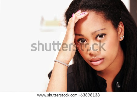 Headache or stress, young office woman in horizontal portrait with copy space - stock photo